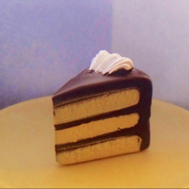 My favorite cake is yellow cake with chocolate icing- even when it's plastic :)