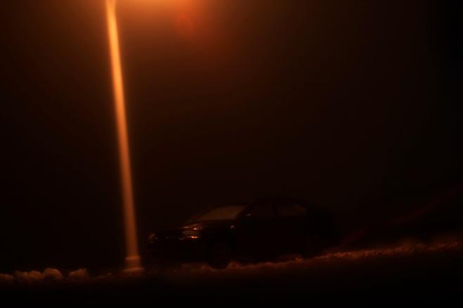 car under street light