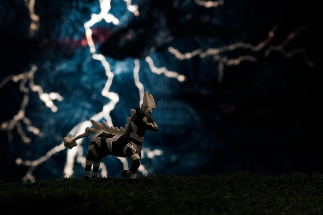 The first of what will most likely be many, Pokemon images. I'll be posting the story of these figures soon, but for now this is a zebra-esque electric type Pokemon called Zebstrika. This figure is about 3cm long. I painted both the figure and the backdrop, backlit and photographed.