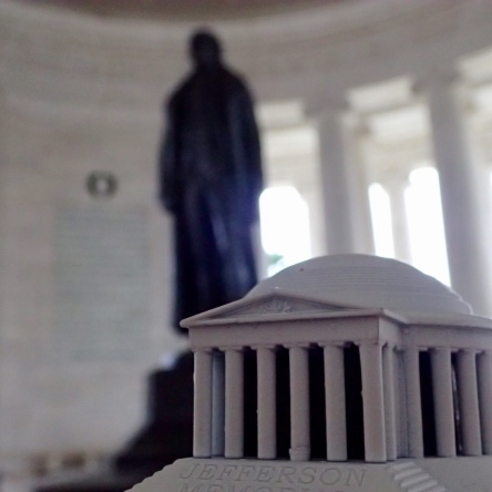 Miniature Jefferson Memorial in front of the Jefferson Memorial, toy photography by Tourmaline .