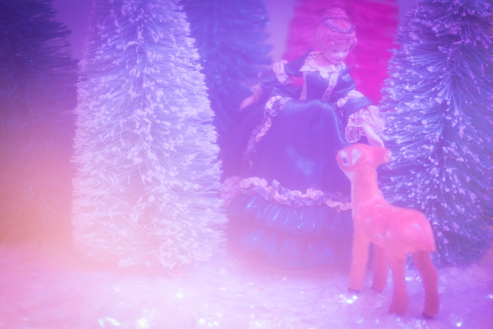 Victorian woman petting deer in pink forest clearing, toy photography by Tourmaline .