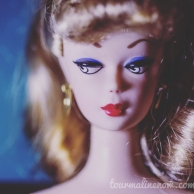 Portrait of side eye vintage barbie, toy photography by Tourmaline .