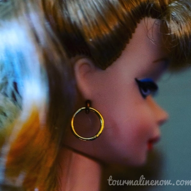 side profile of vintage barbie, toy photography by Tourmaline .