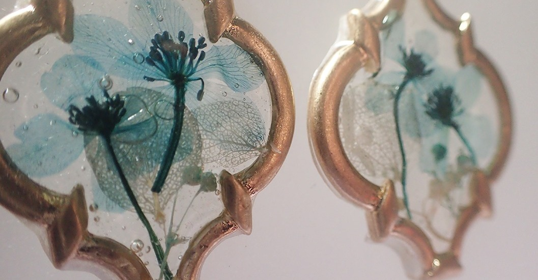 Close up of resin and dried flower open bezel earrings