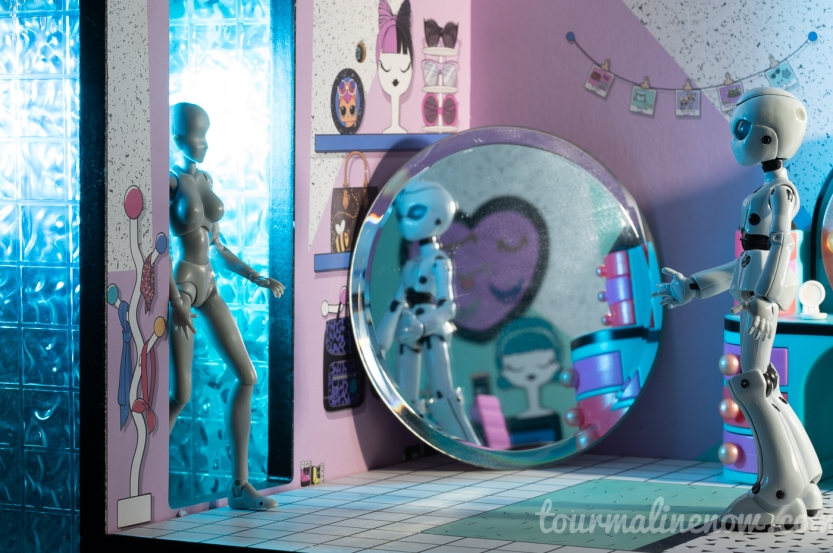 Figure walks into room towards robot, toy photography by Tourmaline .