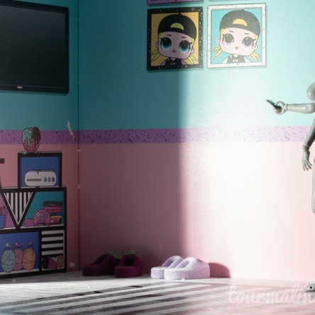 figure turns on TV, toy photography by Tourmaline .