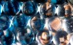 Astronaut reflected into glass orbs, toy photography by Tourmaline .