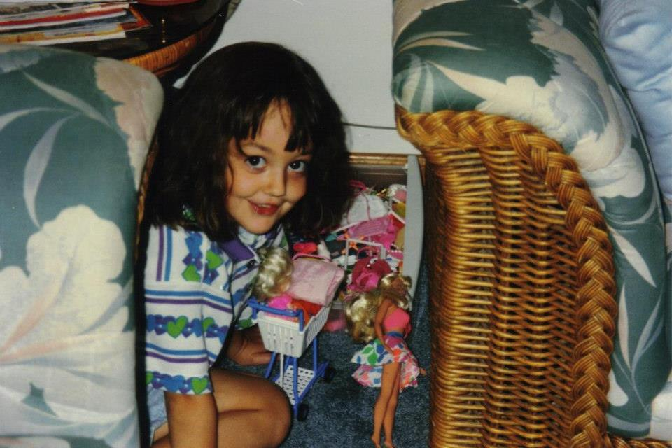 My and my Barbies in between the couch and the side table circa 1996 ish