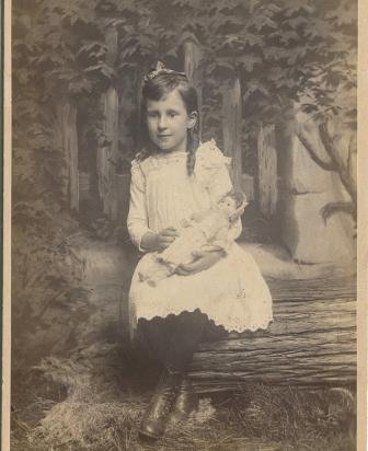 Girl with doll, 1885, Kodak Brownie image
