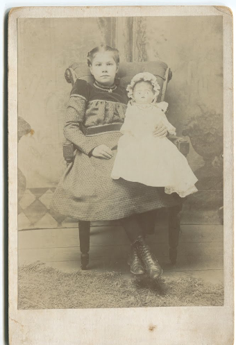 Girl with doll, 1885, Kodak Brownie image